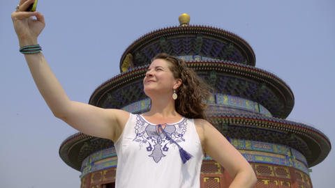 Female tourist takes a selfie at the Temple of Heaven Footage