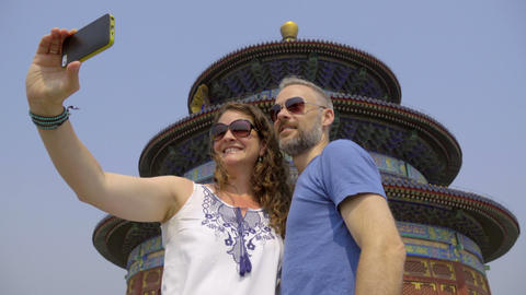 Sunglass wear tourists take selfie at Temple of Heaven Live Action