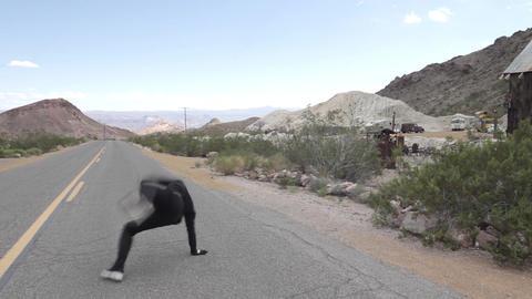 Guy dancing break dance on the road 영상물