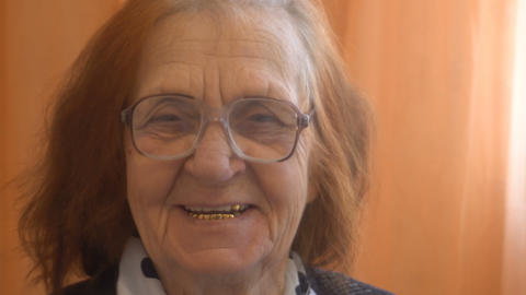 portrait of a smiling elderly woman looking at the camera Footage