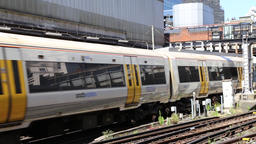 London communter train arriving at Victoria station London UK 영상물