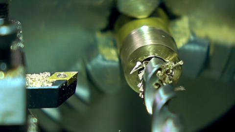 Lathe machine metal drilling, super slow motion. Machining brass piece 500 fps Footage