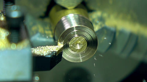 Rotating part of lathe machine and cutter, super slow motion. Machining brass Live Action