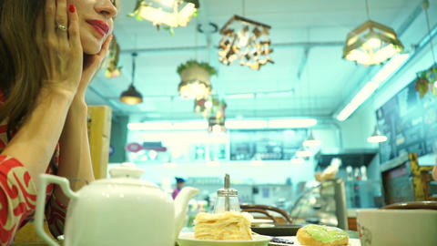Happy couple having their dessert in a cafe. Man regales girl with a cake Footage