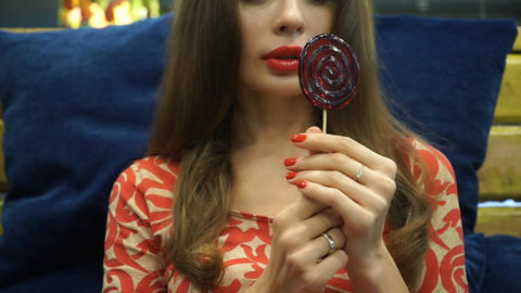 Long hair girl holding red spiral lolly Footage