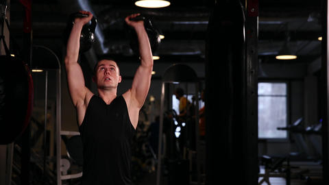A professional athlete performs a one-weight dumbbell with pirsedaniem left and Footage