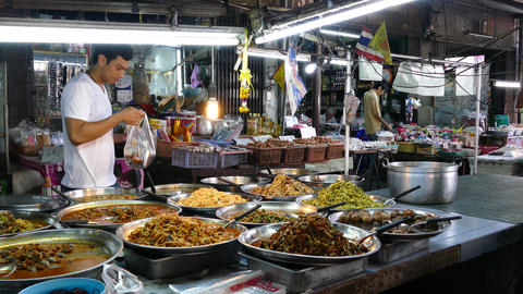 Guy orders Khao kang street food at a market and walks away Footage