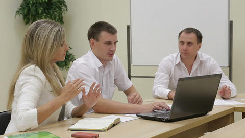 Businessmen discussing diagrams using laptop Footage