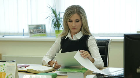 Business woman reading documents in office Footage