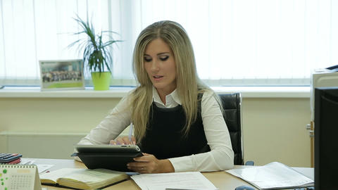 Businesswoman talking to camera on table in office Footage