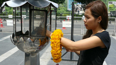 Girl lighting the incense before praying to Phra Pikanet Footage