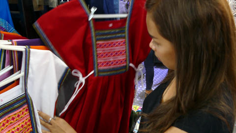 Girl shopping for a typical Northern Thai dress Footage