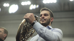 Young Man Playing The French Horn Footage