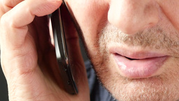 4K Closeup View On Handsome White Old Man Mouth Say Hello On Mobile Phone, Lips  stock footage