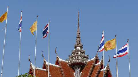 The Thai flag and Dharmacakra flag in front of the prayer hall of Wat Asokaram,  Footage
