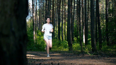 sport activities in the forest on fresh air, a healthy lifestyle, sportsmanship Live Action