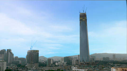 Two buildings under construction with multiple cranes in operation showing Footage