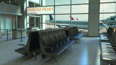 Phnom Penh flight boarding now in the airport terminal. Travelling to Cambodia Footage