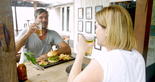 Couple on a relaxed date or vacation cheering with a... Stock Video Footage