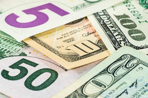 Large dollar bills close-up フォト