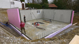 Prefabricated house, workers in setting up the basement walls Footage