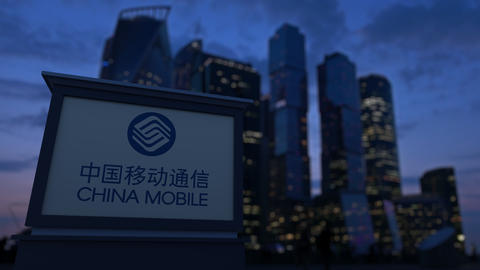 Street signage board with China Mobile logo in the evening. Blurred business Footage