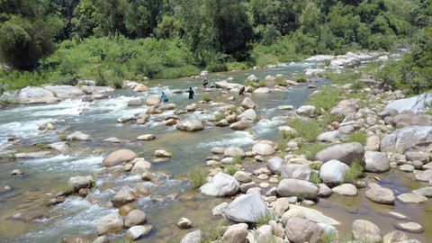 Aerial View Men Fish in Mountain River with Forestry Banks Live Action