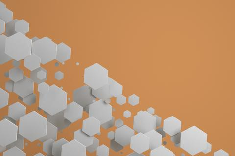 White hexagons of random size on orange background フォト