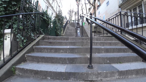 Climbing up stone steps of Rue Chappe in Montmartre, Paris Footage