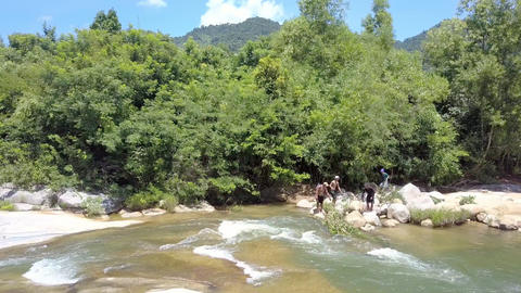 Guys Fish in Foamy River Rapids Water by Forestry Bank Footage