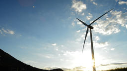 Wind turbine energy renewable moving at cloudy day at sunset Footage
