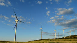 Wind turbines energy renewable moving at field at sunset Footage