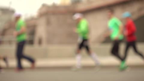 Defocused city marathon runners. Competition concept. Super slow motion Live Action