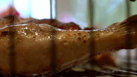 Cooking chicken meat with food burner. 4K close up video Footage
