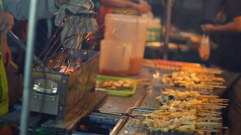 Grilling barbecue street food at night market Footage