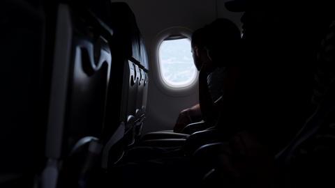 Tourists Looking in Airplane Window. 4K. 19 JAN - Bali, Indonesia Footage