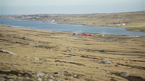 4X4 Vehicle Crossing A Hill In The Falkland Islands (Islas Malvinas) Live Action