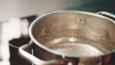 Water starting to boil in pot Live Action