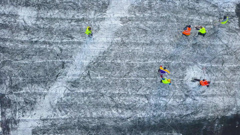 View from the height on unrecognizable people playing hockey in the winter Footage
