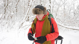 Elderly Caucasian man walks through the winter forest, strayed out of the way Footage
