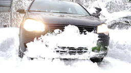 black car slowly drives in a snowy forest, Thick dense thicket of trees and Footage
