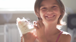 Girl child with kitten slow motion Footage