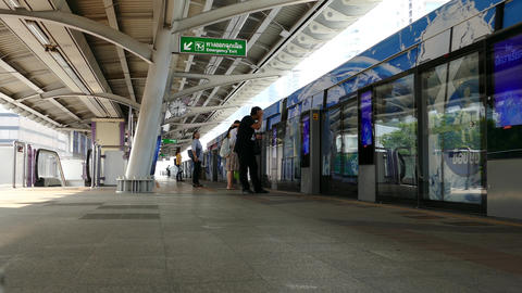People waiting for the BTS train at Chong Nonsi BTS Station Footage