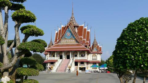 Monk walks towards the prayer hall of Wat Asokaram Footage