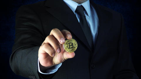 business man holding dollars and bitcoins in his hand. bitcoin shows on screen. Footage