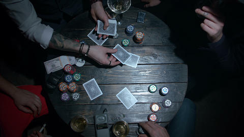 Croupier dealing cards in a poker Live Action