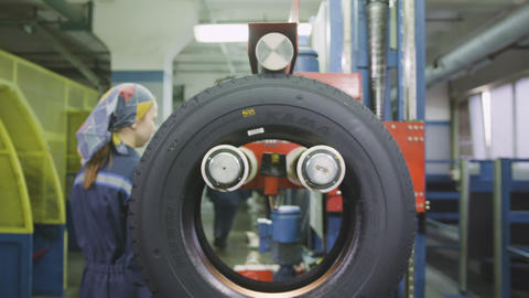 Equipment Stops Rotating Tire Employee Stamps Mark Footage