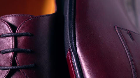 Pair of new classic mens boots. 4K pan telephoto lens shot Footage