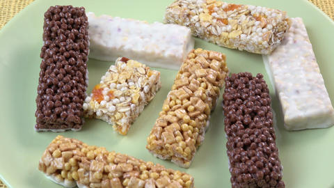 Various healthy granola bars (muesli or cereal bar) Live Action