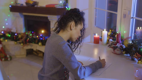 Pretty brunette writes a wish list at the Christmas Footage